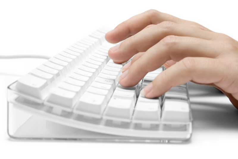 white-keyboard-and-hand